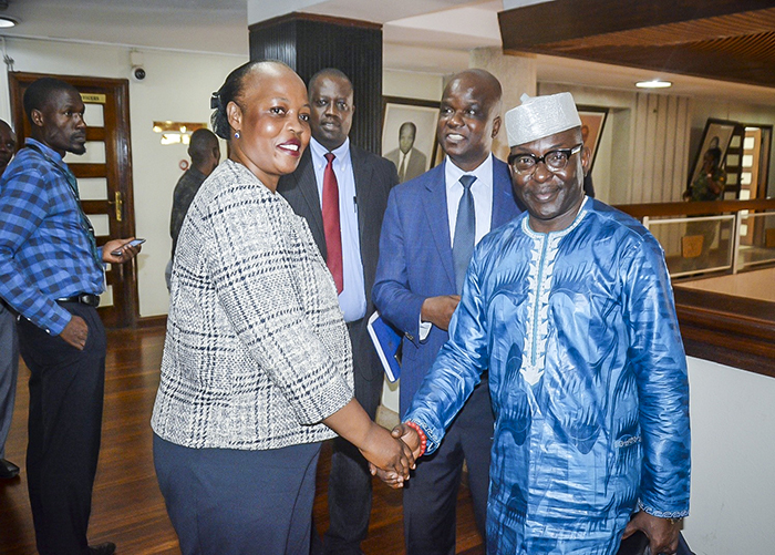 ICASA Director in a handshake with the Sironko Woman MP, the current chairperson of the Parliamentary Committee on HIV/AIDS and other related diseases, Florence Nambozo Mayoga