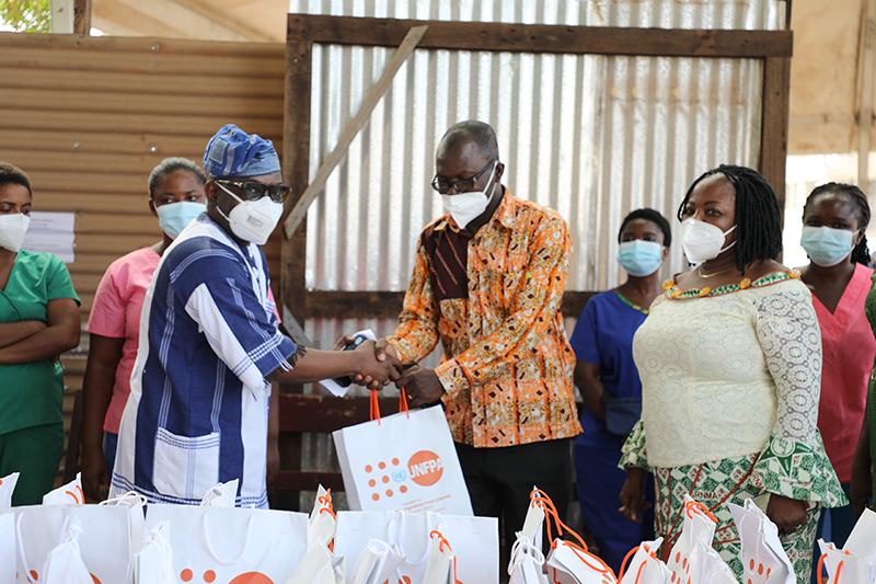 Mr. Luc Armand Bodea, SAA Coordinator/ICASA Director handing over donated items to Dr. Peter Pupulampu, Head of Fevers Unit and Mrs. Elizabeth Akua Dzokoto, Deputy Head of Fevers Unit